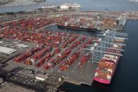 FILE PHOTO: Shipping containers are unloaded from ships at a container terminal at the Port of Long Beach-Port of Los Angeles complex, amid the coronavirus disease (COVID-19) pandemic, in Los Angeles