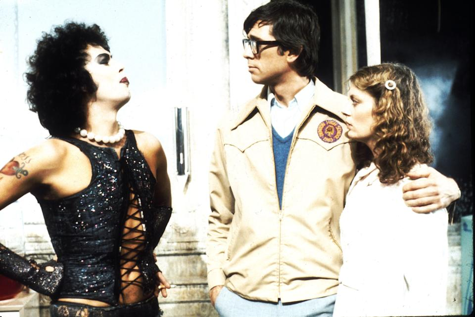 """1975:  Actors Tim Curry, Barry Bostwick and Susan Sarandon  in scene from movie """"The Rocky Horror Picture Show"""" directed by Jim Sharman.   (Photo by Michael Ochs Archives/Getty Images)"""