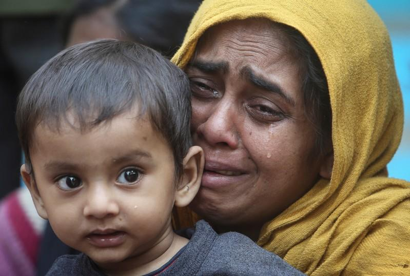 FILE PHOTO: A Rohingya Muslim woman cries as she holds her daughter after they were detained by Border Security Force (BSF) soldiers while crossing the India-Bangladesh border from Bangladesh, at Raimura village on the outskirts of Agartala