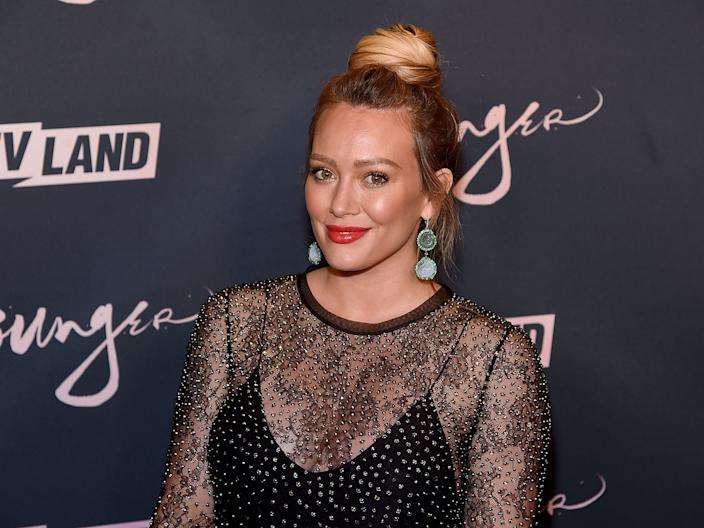 Hilary Duff poses for photographers.