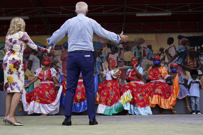 Democratic presidential candidate former Vice President Joe Biden and his wife Jill Biden talk with dancers who performed as they visit Little Haiti Cultural Complex, Monday, Oct. 5, 2020, in Miami. (AP Photo/Andrew Harnik)