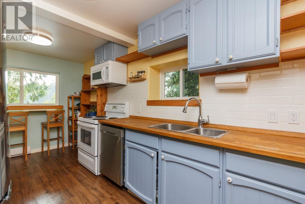 """<p><a rel=""""nofollow"""">2615 Savory Rd., Victoria, B.C.</a><br /> The whole house is filled with windows, bringing in lots of natural light.<br /> (Photo: Zoocasa) </p>"""