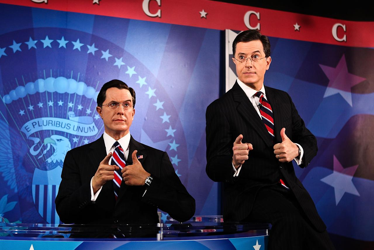 Stephan Colbert poses for photos with his wax figure at the Stephen Colbert wax figure unveiling at Madame Tussauds on November 16, 2012 in Washington, DC.  (Photo by Paul Morigi/WireImage)