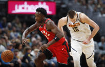 Toronto Raptors forward OG Anunoby, front, pursues the ball as Denver Nuggets center Nikola Jokic pursues in the first half of an NBA basketball game Sunday, March 1, 2020. (AP Photo/David Zalubowski)