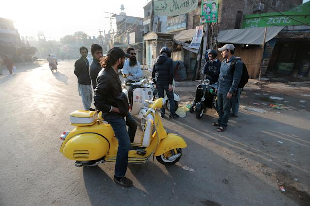 <p>Members of a Vespa rider's club gather at sunrise for a ride in Lahore, Pakistan March 11, 2018. (Photo: Caren Firouz/Reuters) </p>