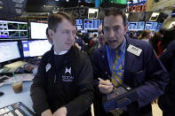 Specialist Peter Elkins, left, and trader Gregory Rowe work on the floor of the New York Stock Exchange, Thursday, Dec. 12, 2013. Lower U.S. stock prices on Thursday set up investors for what would be their third day in a row of declines. (AP Photo/Richard Drew)