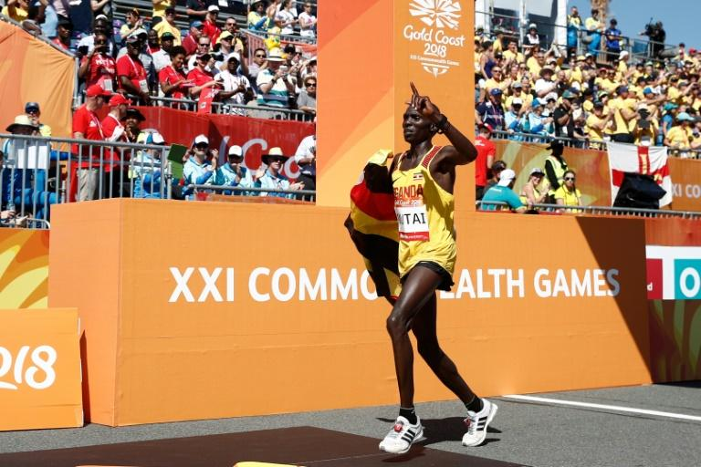 Uganda's Munyo Solomon Mutai reacts as he crosses the finish line in second place in the men's marathon during the 2018 Gold Coast Commonwealth Games