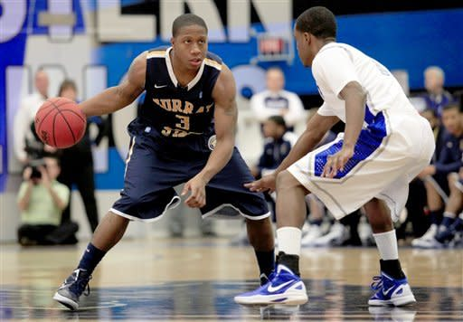 Murray State's Isaiah Canaan (3) looks for room against the defense of Eastern Illinois' Jeremy Granger (12) during the first half of an NCAA college basketball game on Friday, Dec. 30, 2011, in Charleston, Ill. (AP Photo/ Stephen Haas)