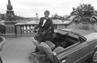 <p>Roger Moore on set of A View to a Kill with half a car during filming in Paris, France.</p>