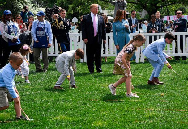 PHOTO: President Donald Trump and First Lady Melania Trump look on during the annual White House Easter Egg Roll, April 22, 2019. (Jim Watson/AFP/Getty Images)