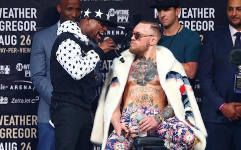 <span>Floyd Mayweather and Conor McGregor exchange insults during their promotional tour</span> <span>Credit: Getty Images </span>