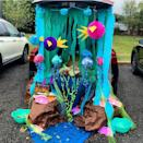 """<p>Transform your trunk into a deep sea adventure in a snap. Trick-or-treaters will feel like they are on a tropical island when they stop by your festive trunk. You can get as creative as you want with this look.</p><p>Attach blue and green streamers to your trunk with a few underwater friends, like <a href=""""https://www.amazon.com/Jellyfish-Lanterns-Mermaid-Honeycomb-Decoration/dp/B0859D2XJB?tag=syn-yahoo-20&ascsubtag=%5Bartid%7C2089.g.33658548%5Bsrc%7Cyahoo-us"""" rel=""""nofollow noopener"""" target=""""_blank"""" data-ylk=""""slk:hanging jellyfish"""" class=""""link rapid-noclick-resp"""">hanging jellyfish</a>. </p><p><a class=""""link rapid-noclick-resp"""" href=""""https://www.amazon.com/Coceca-Four-Leaf-Garland-Streamers-Decoration/dp/B07DL7BJG2?tag=syn-yahoo-20&ascsubtag=%5Bartid%7C2089.g.33658548%5Bsrc%7Cyahoo-us"""" rel=""""nofollow noopener"""" target=""""_blank"""" data-ylk=""""slk:Shop Underwater Streamers"""">Shop Underwater Streamers</a></p>"""