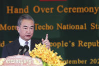 Chinese Foreign Minister Wang Yi delivers a speech during a ceremony to hand over the Morodok Techo National Stadium to the the Cambodian organizing committee of the Southeast Asian Games, in Phnom Penh, Cambodia, Sunday, Sept. 12, 2021. Wang is visiting Cambodia, where's he expected to meet with Prime Minister Hun Sen and other officials to discuss COVID-19 and other regional issues. (Lon Jadina/Pool Photo via AP)