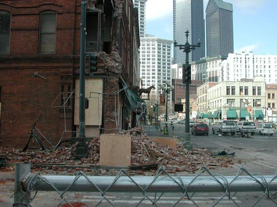 Rubble is seen in front of a damaged building.
