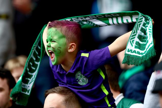 GLASGOW, SCOTLAND - APRIL 16: A young Hibernian fan sings during the Scottish Cup Semi Final between Hibernian and Dundee United at Hampden Park on April 16, 2016 in Glasgow, Scotland. (Photo by Clive Rosel/Getty) (Photo by Clive Rose/Getty Images)
