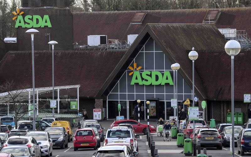 Shoppers leave the Asda superstore in High Wycombe