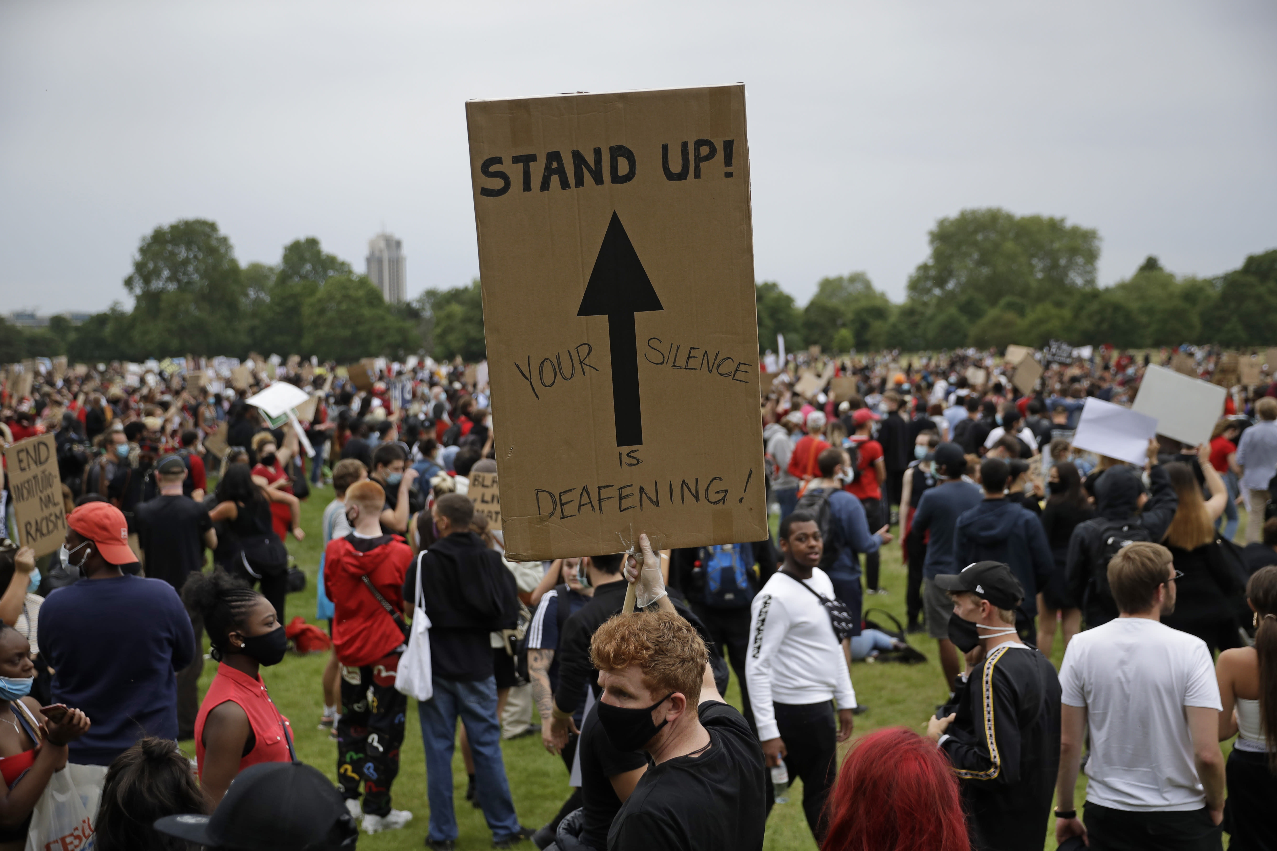 Protesters take part in a demonstration on Wednesday, June 3, 2020, in Hyde Park, London, over the death of George Floyd, a black man who died after being restrained by Minneapolis police officers on May 25. Protests have taken place across America and internationally, after a white Minneapolis police officer pressed his knee against Floyd's neck while the handcuffed black man called out that he couldn't breathe. The officer, Derek Chauvin, has been fired and charged with murder. (AP Photo/Matt Dunham)