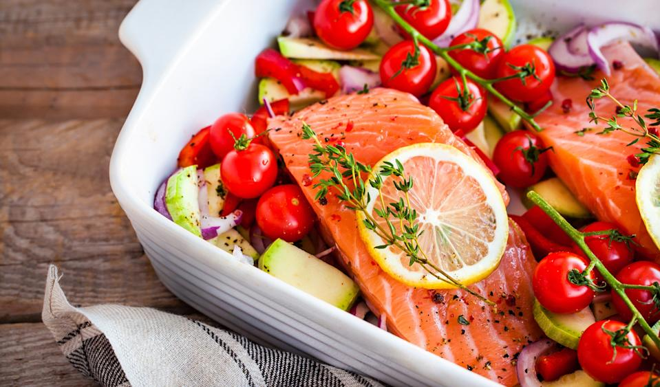 Experts have recommended consuming lots of 'healthy' fats like oily fish in your diet (Getty Images)