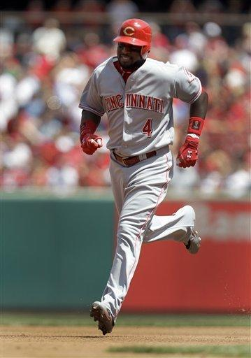 Cincinnati Reds' Brandon Phillips rounds the bases after hitting a solo home run during the fourth inning of a baseball game against the St. Louis Cardinals Thursday, April 19, 2012, in St. Louis. (AP Photo/Jeff Roberson)