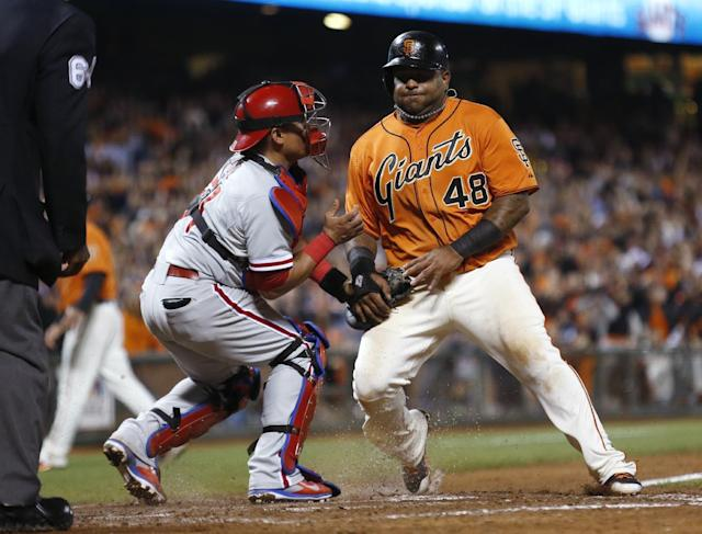 San Francisco Giants' Pablo Sandoval is tagged out at home plate by Philadelphia Phillies catcher Carlos Ruiz during the eighth inning of a baseball game, Friday, Aug. 15, 2014, in San Francisco. (AP Photo/Beck Diefenbach)