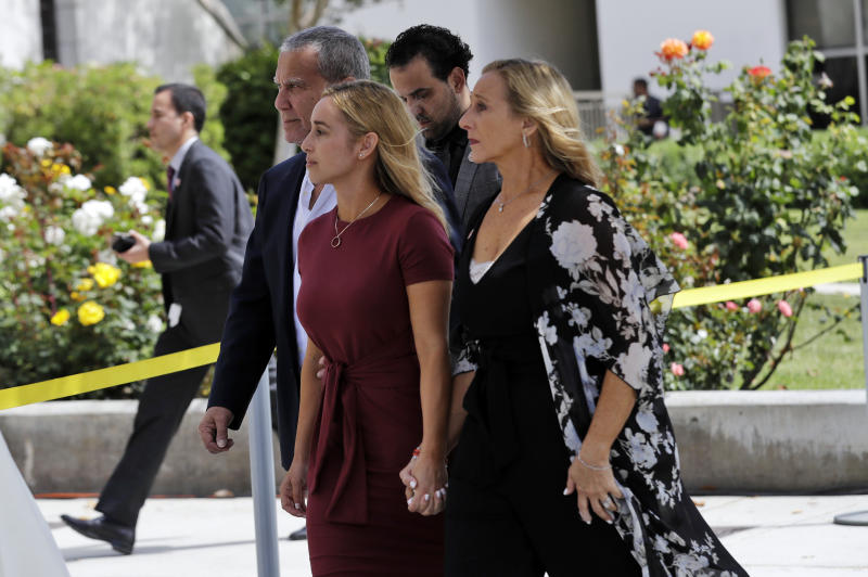 Carli Skaggs, center in burgundy dress, walks into St. Monica Catholic Church for a memorial for her husband, Los Angeles Angels pitcher Tyler Skaggs, Monday, July 22, 2019, in Los Angeles. (AP Photo/Marcio Jose Sanchez)