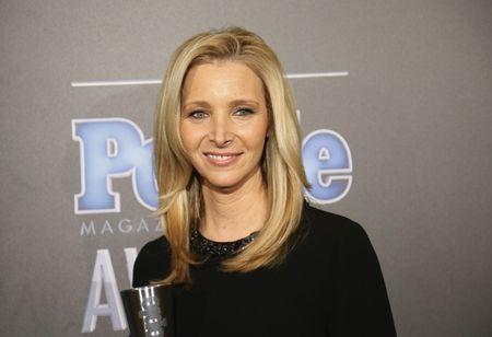 """Actress Lisa Kudrow poses backstage with her award for TV Performance of the Year for """"The Comeback"""" at the People Magazine Awards in Beverly Hills"""