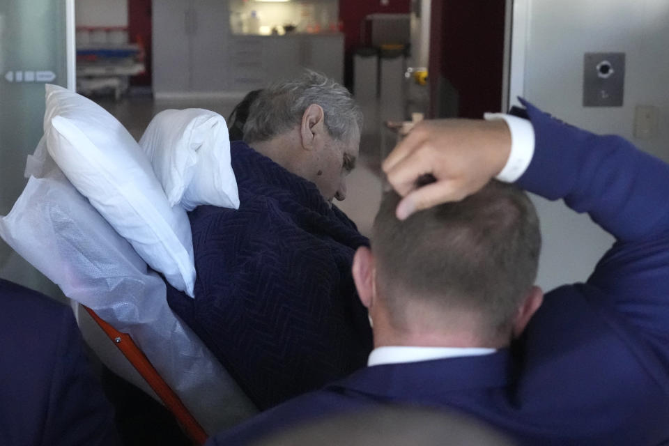 Czech Republic's President Milos Zeman is admitted to the Military hospital in Prague, Czech Republic, Sunday, Oct. 10, 2021. Zeman is a heavy smoker who has suffered from diabetes and neuropathy linked to it. He has trouble walking and has been using a wheelchair. (AP Photo/Petr David Josek)