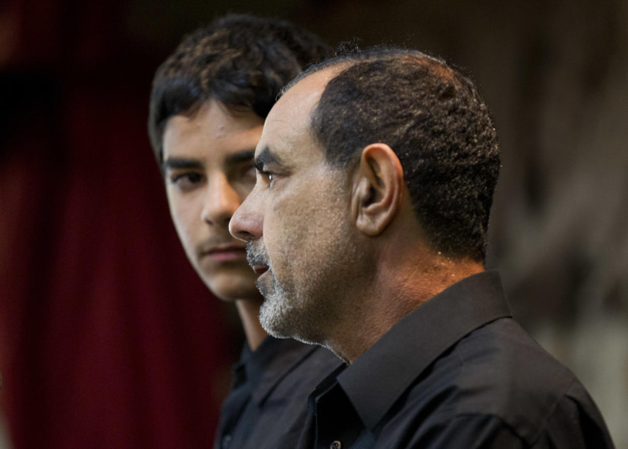 Kassim Alhimidi, right, speaks alongside his son, Mohammed Alhimidi, during a memorial for his wife, Shaima Alawadi at a mosque Tuesday, March 27, 2012, in Lakeside, Calif. The body of Alawadi, who grew up in Iraq and wore the Muslim headscarf, was found severely beaten in her surburban San Diego home on March 21st. (AP Photo/Gregory Bull)