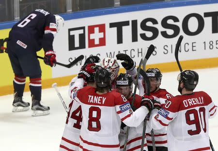 Ice Hockey - 2016 IIHF World Championship - Semi-final - Canada v USA - Moscow, Russia - 21/5/16 - Canada's players celebrate their victory against the U.S. REUTERS/Grigory Dukor