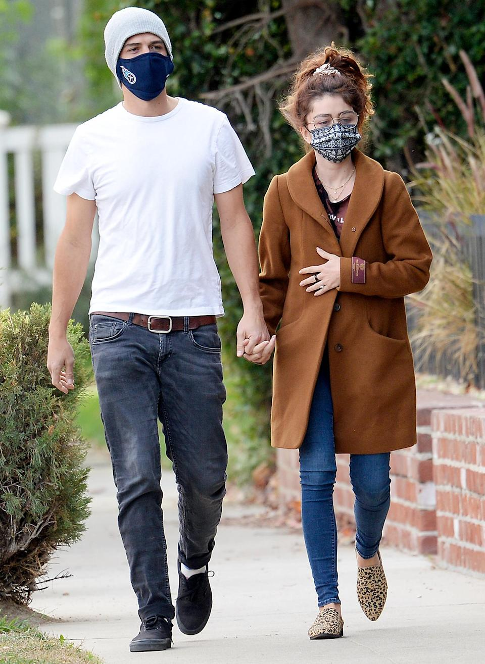 <p>Sarah Hyland and Wells Adams hold hands on a Tuesday walk through West Hollywood.</p>