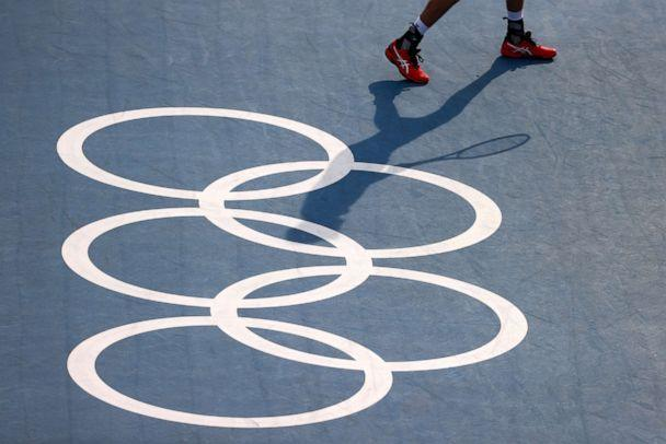 PHOTO: The olympic rings are seen in the semifinal match between Ivan Dodig of Croatia and Marin Cilic of Croatia against Marcus Daniell of New Zealand and Michael Venus of New Zealand on July 29, 2021. (Edgard Garrido/Reuters)