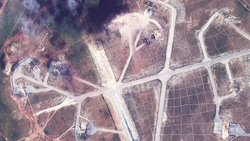 This satellite image provided by DigitalGlobe shows an image captured on April 7 of the northwest side of the Shayrat air base in Syria, following U.S. Tomahawk Land Attack Missile strikes on Friday, April 7, 2017 from the USS Ross (DDG 71) and USS Porter (DDG 78). The United States blasted the air base with a barrage of cruise missiles on Friday, April 7, 2017 in fiery retaliation for this week's gruesome chemical weapons attack against civilians. (DigitalGlobe via AP)