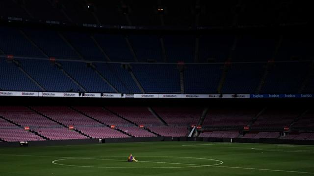 Powerful images show Andres Iniesta sitting on the Camp Nou pitch after saying goodbye to the Barcelona fans.