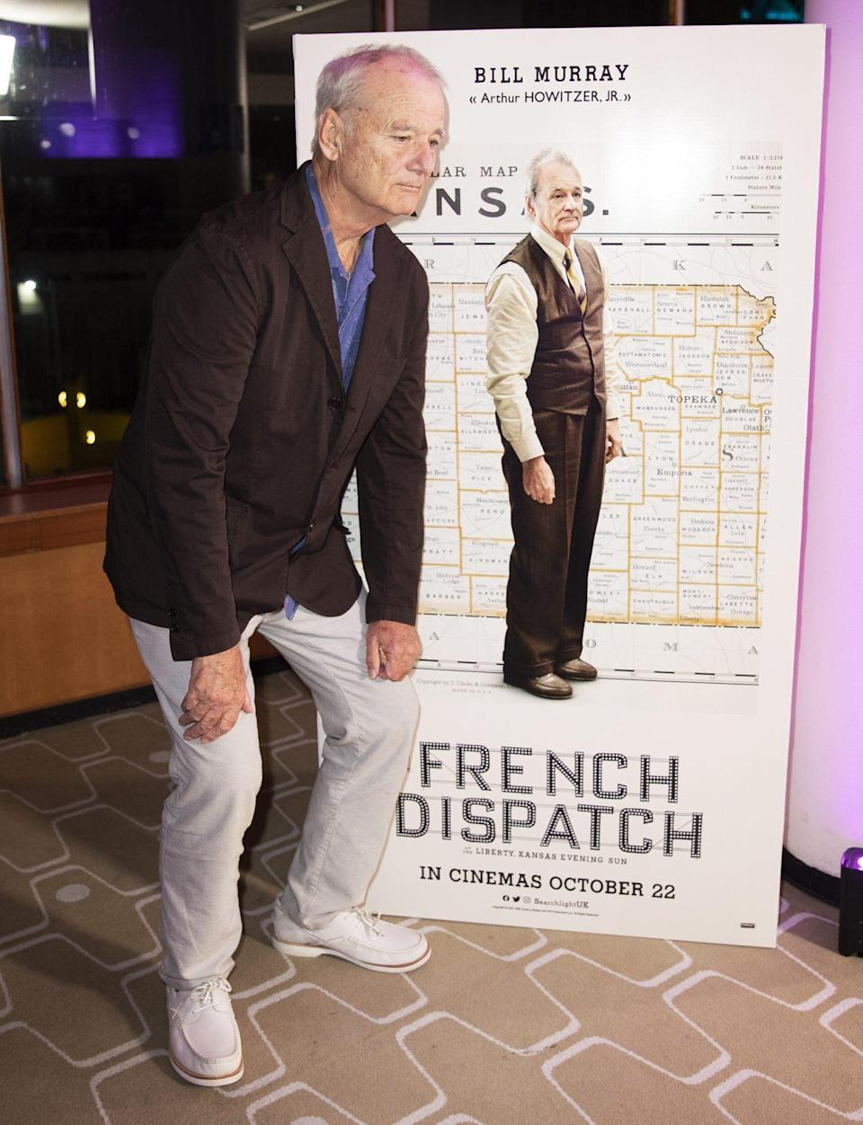 <p>Bill Murray poses with his movie poster at the U.K. premiere of his film <em>The French Dispatch</em> on Oct. 10 in London.</p>