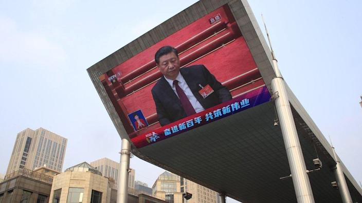 The large screen, Xi Jinping China President has attended the closing session of the Beijing national conference was held in China (NPC) will appear in the March 11, 2021.