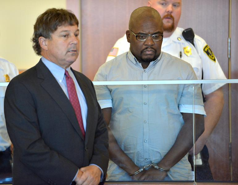 Ernest Wallace of Bristol, Conn., center, an associate of former New England Patriots player Aaron Hernandez, stands beside his attorney David Meier, left, during his arraignment in Superior Court Thursday, Sept. 19, 2013, in Fall River, Mass. Wallace pleaded not guilty to an accessory to murder charge in connection with the death of Odin Lloyd, 27, whose body was found in North Attleborough, Mass., about a mile from Hernandez's home. (AP Photo/Josh Reynolds, Pool)