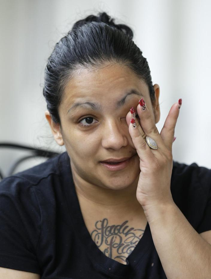 Wendy Gonzales, a resident of the Anna Louise Inn, wipes a tear from her eye while talking on Thursday, May 16, 2013 about her time at the home for struggling women in Cincinnati. In a deal with Western & Southern Insurance Group, who bought the 104-year-old inn for $4 million, the women now living there will remain where they are for two years as a new facility for them is built. (AP Photo/Al Behrman)