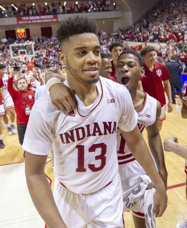 Indiana forward Juwan Morgan (13) and guard Aljami Durham (1) celebrate on the court after defeating Michigan State in an NCAA college basketball game, Saturday, March 2, 2019, in Bloomington, Ind. Indiana won 63-62. (AP Photo/Doug McSchooler)