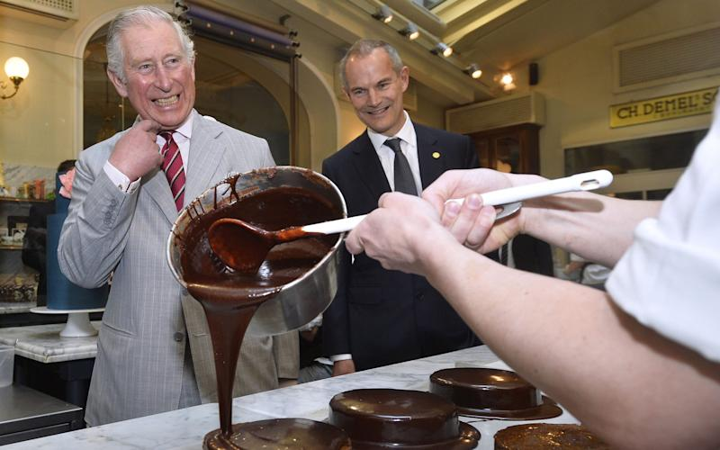 Prince Charles, Prince of Wales (L) and British Ambassador to Austria, Leigh Turner (R), visit the traditional Viennese coffee house Demel - Credit: Getty Images