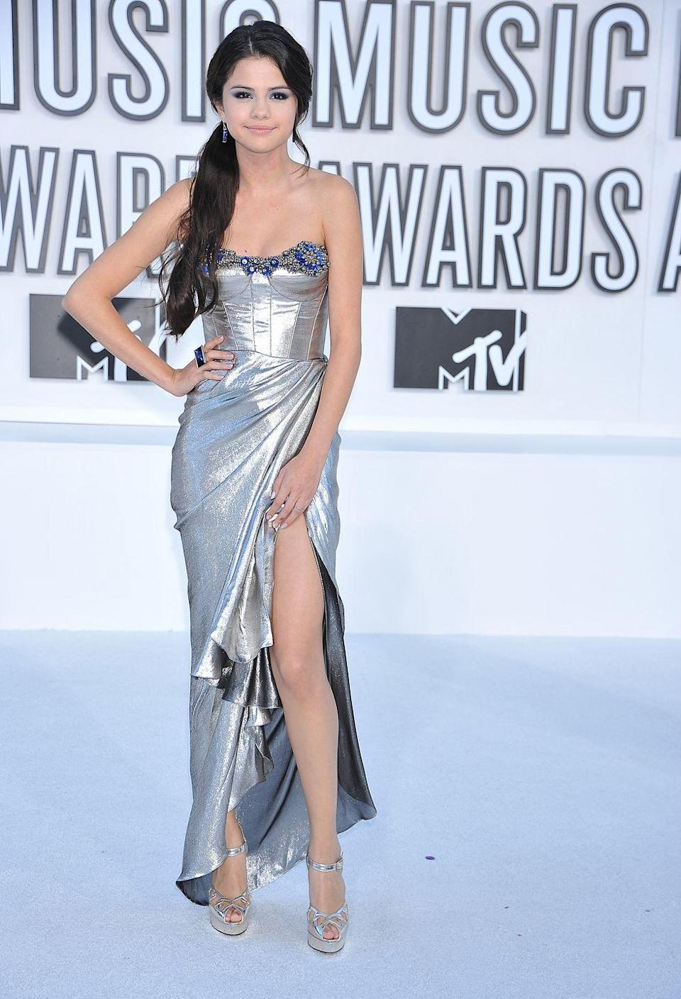 <p>Selena Gomez glowed in this silver gown with a thigh-high slit at the 2010 VMAs.</p>