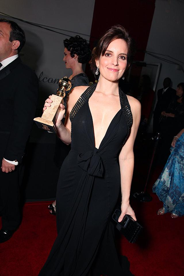 "Funny lady Tina Fey partied all night long with her trophy by her side. Eric Charbonneau/<a href=""http://www.wireimage.com"" target=""new"">WireImage.com</a> - January 11, 2009"