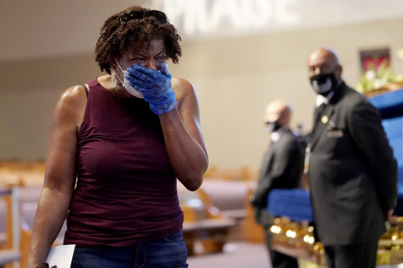 Image: Charlene Thompson cries as she passes the casket of George Floyd in Houston on June 8, 2020. (David J. Phillip / Pool via AP)