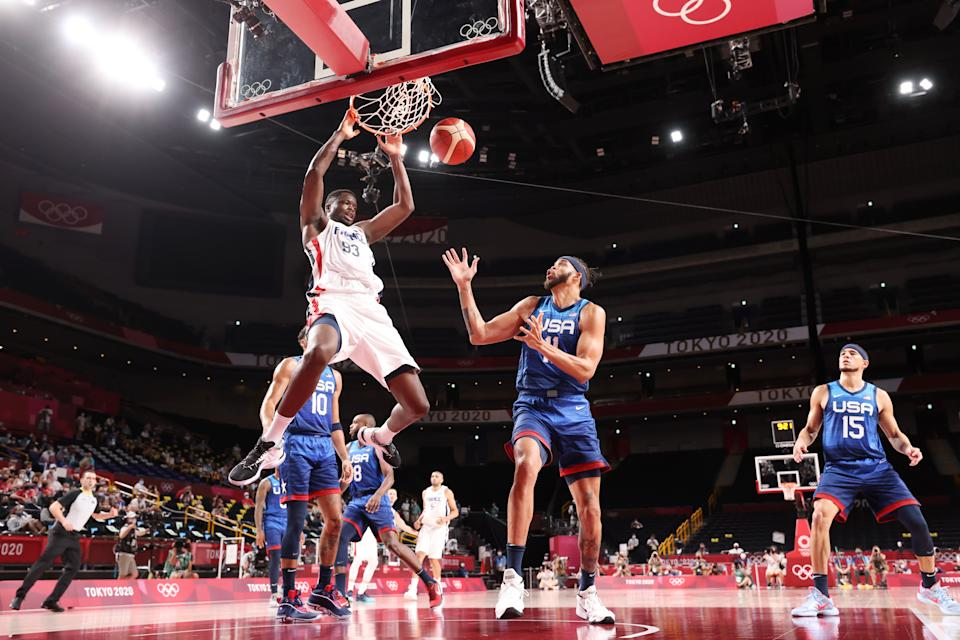 SAITAMA, JAPAN - JULY 25: Moustapha Fall #93 of Team France dunks the ball over JaVale McGee #11 of Team United States during the second half of the Men's Preliminary Round Group B game on day two of the Tokyo 2020 Olympic Games at Saitama Super Arena on July 25, 2021 in Saitama, Japan. (Photo by Gregory Shamus/Getty Images)