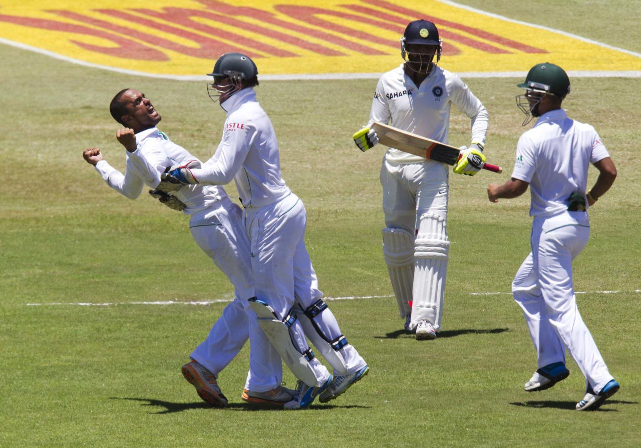 South Africa's Robin Peterson (L) and AB de Villiers (2nd L) celebrate the wicket of India's Ravindra Jadeja, as South Africa's JP Duminy (R) looks on, during the fifth day of the second test cricket match in Durban, December 30, 2013. REUTERS/Rogan Ward (SOUTH AFRICA - Tags: SPORT CRICKET TPX IMAGES OF THE DAY)