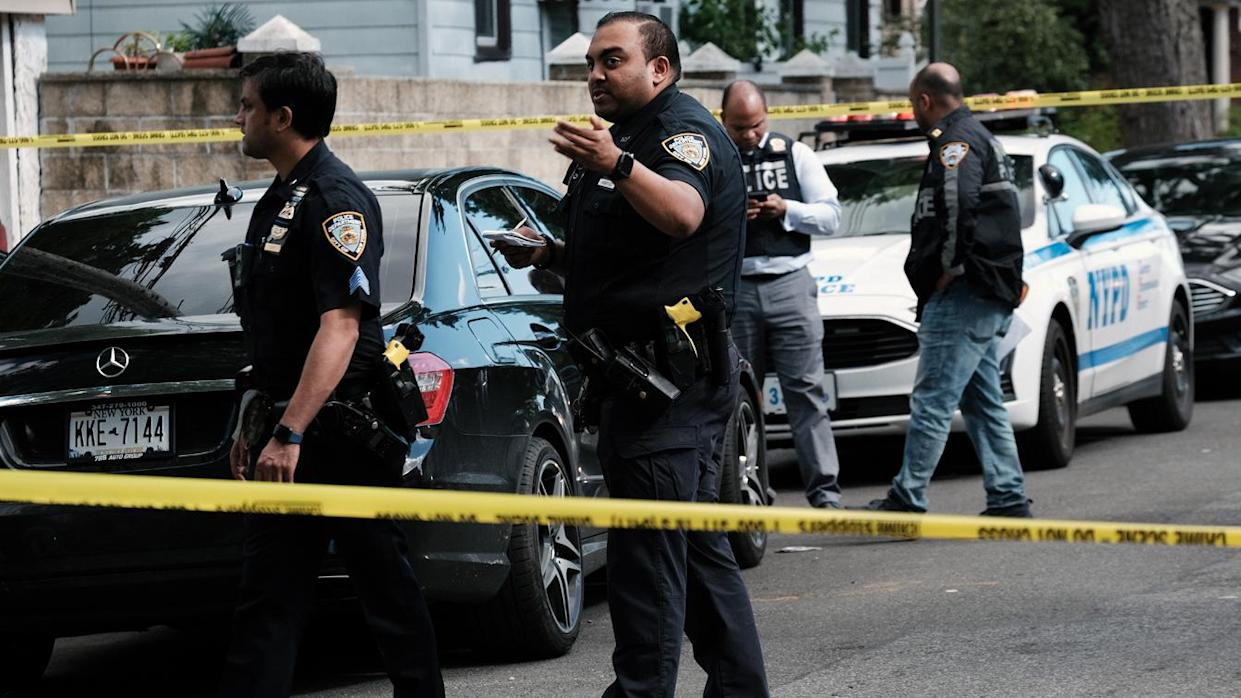 Police investigate the scene of a shooting in Brooklyn, N.Y., on June 23.
