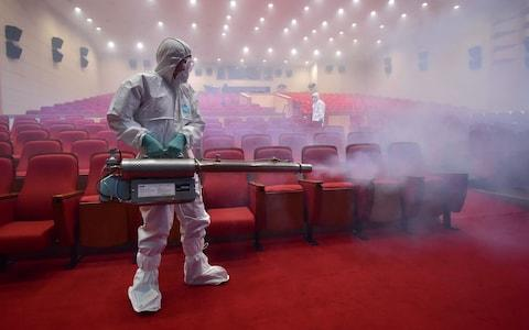 MERS continues to be a issue worldwide. This image shows a health worker fumigating a theatre in Seoul, South Korea, in 2015  - Credit: JUNG YEON-JE/AFP