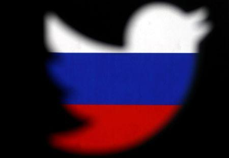 FILE PHOTO: A 3D-printed Twitter logo displayed in front of Russian flag is seen in this illustration picture, October 27, 2017. REUTERS/Dado Ruvic/Illustration/File Photo