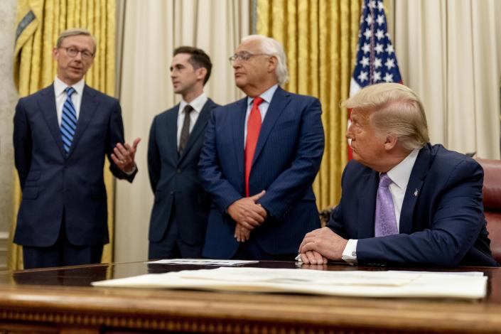From left, U.S. special envoy for Iran Brian Hook, accompanied by from left, Avraham Berkowitz, Assistant to the President and Special Representative for International Negotiations, U.S. Ambassador to Israel David Friedman, and President Donald Trump, speaks in the Oval Office at the White House, Wednesday, Aug. 12, 2020, in Washington. Trump said on Thursday that the United Arab Emirates and Israel have agreed to establish full diplomatic ties as part of a deal to halt the annexation of occupied land sought by the Palestinians for their future state. (AP Photo/Andrew Harnik)