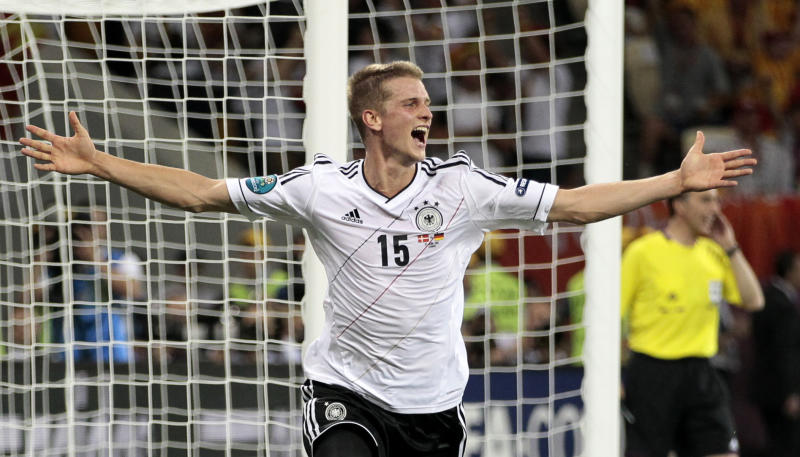 Germany's Lars Bender celebrates after scoring his side's second goal during the Euro 2012 soccer championship Group B match between Denmark and Germany in Lviv, Ukraine, Sunday, June 17, 2012. (AP Photo/Ivan Sekretarev)