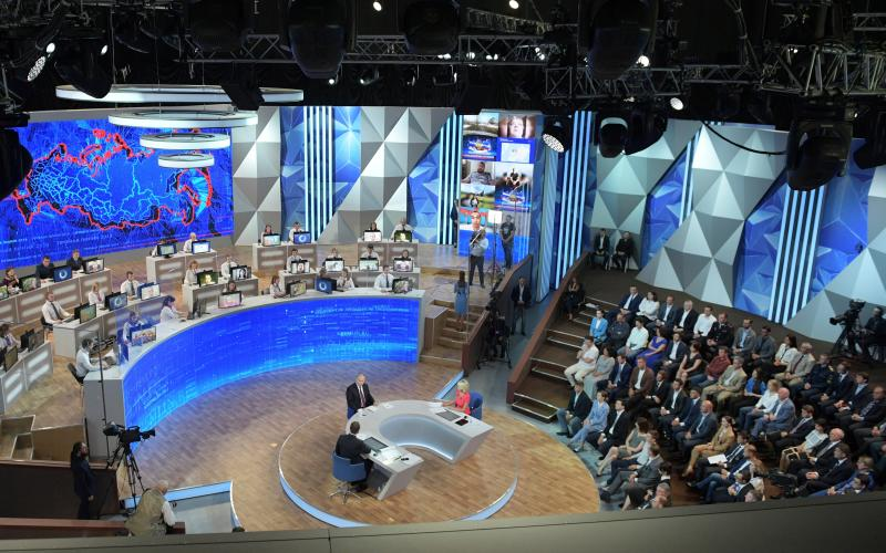 Russian President Vladimir Putin attends an annual call-in show in Moscow, Russia, Thursday, June 20, 2019. Putin hosts call-in shows every year, which typically provide a platform for ordinary Russians to appeal to the president on issues ranging from foreign policy to housing and utilities. (Alexei Druzhinin, Sputnik, Kremlin Pool Photo via AP)
